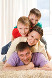 Happy parents and their children Stock Images