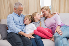 Happy parents with their children on sofa Royalty Free Stock Image