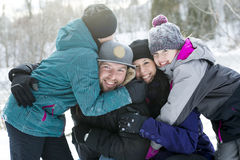 Happy parents and their kids in winterwear Stock Photo