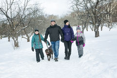 Happy parents and their kids in winterwear Stock Image
