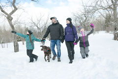 Happy parents and their kids in winterwear Royalty Free Stock Photos