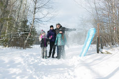 Happy parents and their kids in winterwear Royalty Free Stock Photo