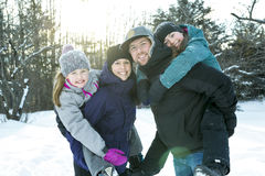 Happy parents and their kids in winterwear Royalty Free Stock Photography