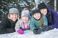 Happy parents and their kids in winterwear Stock Photos