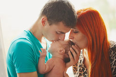 Happy parents with their newborn baby Stock Photos