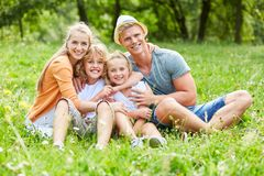 Happy parents and their two children stock image