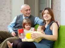 Happy parents with their two kids Stock Images