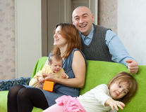 Happy parents with their two kids Stock Photos