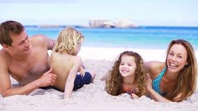 Happy parents tickling their children stock video