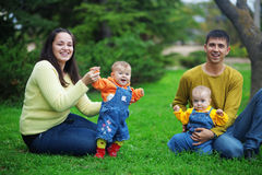 Happy parents with twins Royalty Free Stock Image