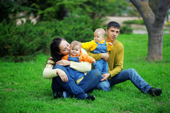 Happy parents with twins Stock Photography