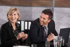 Happy partners working in office Royalty Free Stock Photos