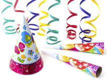 Happy Party. Party accessories, hat, serpentina (ribbons) and blowers, isolated on white background Stock Photos