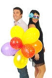 Happy party couple with balloons Royalty Free Stock Photography