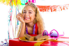 Happy party girl with presents eating chocolate Stock Photo