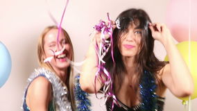 Happy party girls having fun dancing using props in party photo booth stock video