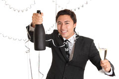 Happy party guy with champagne bottle Royalty Free Stock Photography