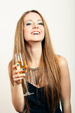 Happy party woman with a glass of champagne Stock Photo