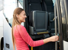 Happy passenger boarding on travel bus Royalty Free Stock Image