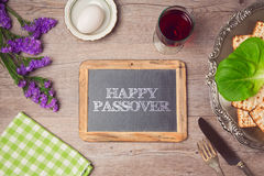 Happy Passover holiday greeting on chalkboard. View from above Stock Images