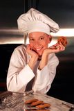 Happy Pastry Chef. In kitchen with chocolate chip cookies Royalty Free Stock Photos