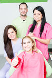 Happy patient and dental team. In dentist office royalty free stock images