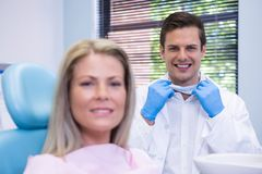 Happy patient and dentist  at dental clinic Royalty Free Stock Photography