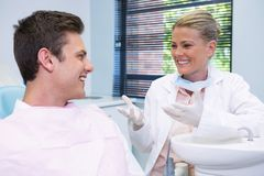 Happy patient discussing with dentist Royalty Free Stock Photos