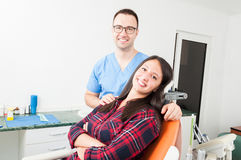 Happy patient and doctor in dentist chair Stock Photography