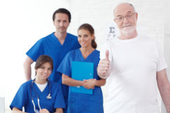 Happy patient and doctors Royalty Free Stock Photos