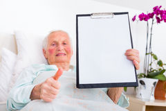 Happy patient holding copyspace Stock Photography