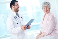 Happy patient in hospital Stock Image