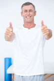 Happy patient looking at camera thumbs up Stock Photos