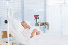 Happy patient lying on her bed Stock Images