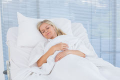 Happy patient lying on her bed Royalty Free Stock Photos