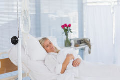 Happy patient lying on her bed Royalty Free Stock Image