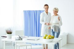 Happy patient and smiling dietitian. Satisfied with the results of a personalized diet Royalty Free Stock Photography