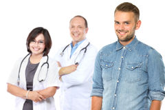 Happy patient standing in front of his doctor Royalty Free Stock Images