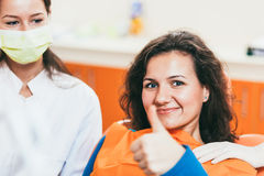 Happy patient after a tooth extraction. Happy female  patient after tooth extraction Royalty Free Stock Photography
