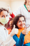 Happy patient after tooth extraction Stock Photography