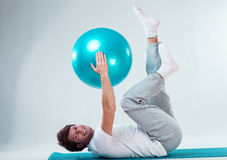 Happy patient training with fitness ball Stock Image