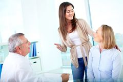 Happy patients. Portrait of female patient looking at her happy friend at medical consultation in hospital Royalty Free Stock Image