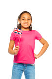 Happy patriotic girl holding UK flag Stock Photo