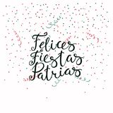 Happy patriotic holidays Spanish quote. Hand written calligraphic Spanish lettering quote Happy patriotic holidays with falling confetti, serpentine. Isolated Stock Images