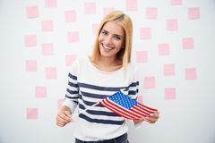 Happy patriotic woman holding US flag Stock Image