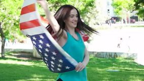 Happy patriotic  young woman with the American stock video