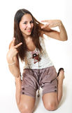 Happy Peace-Loving Teen. A happy, peace-loving, exchange student dressed in typical Thailand fashion for teens Stock Photo