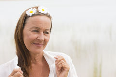 Happy peaceful mature woman outdoor Stock Photos