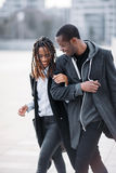 Happy pedestrian couple. Joyful African American. Stylish young people on street, youth love relationships, beauty concept Stock Images