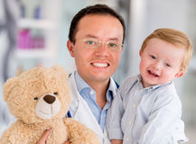 Happy pediatrician Stock Photo